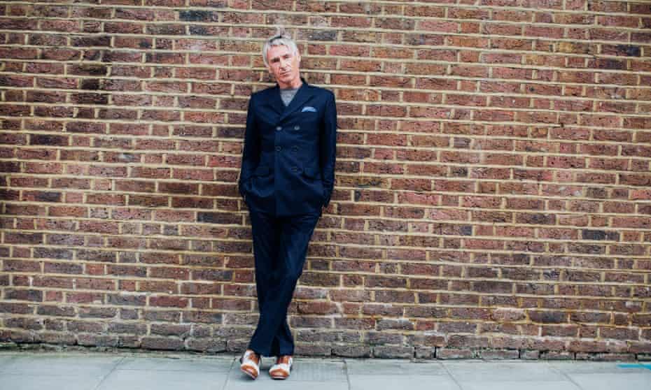 Paul Weller models a suit