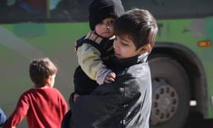 Syrian children evacuated from rebel-held neighbourhoods in Aleppo
