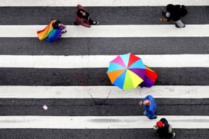 Splashes of rainbow against a black and white road