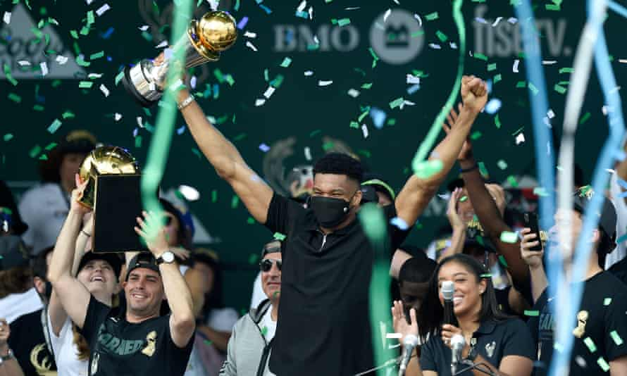 Giannis Antetokounmpo celebrates during a victory parade in the Deer District in Milwaukee.