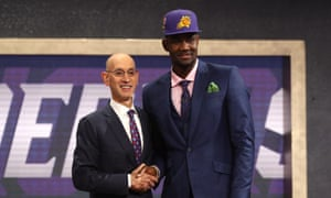 timeless design d82d7 d54b1 Deandre Ayton poses with NBA Commissioner Adam Silver after being drafted  by the Phoenix Suns.