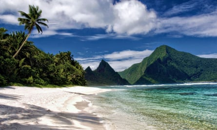 A secluded tropical sand beach and fringing reef in the Samoa National Park in Ofu Island, American Samoa