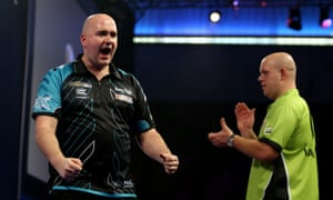 Rob Cross celebrates after defeating Michael van Gerwen to continue his incredible run at his first world championship.