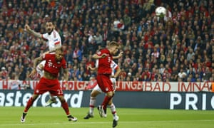 Benfica''s Kostas Mitroglou gets up well but can't direct his header towards the Bayern goal.