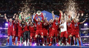 Liverpool celebrate with the trophy after winning the Champions League final.