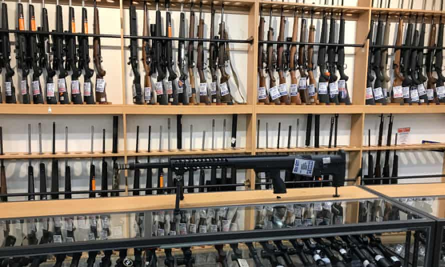 FILE PHOTO: Firearms and accessories are displayed at Gun City gunshop in Christchurch, New Zealand, March 19, 2019. REUTERS/Jorge Silva/Files