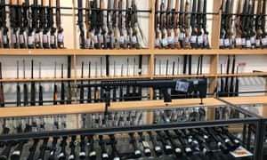Firearms and accessories are displayed at Gun City gunshop in Christchurch, New Zealand