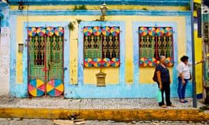 Brazilians residents outside a shop.