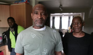Anthony Bryan at home in north London with his wife and son.