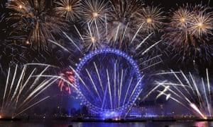 Fireworks explode over the London Eye during the New Year's eve celebrations after midnight in London