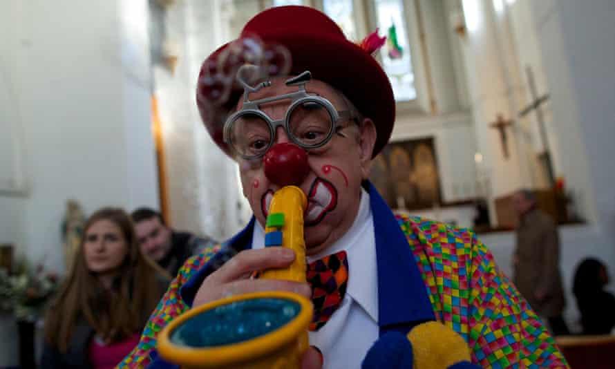 Clowns attend a service in memory of celebrated clown Joseph Grimaldi in Dalston, London