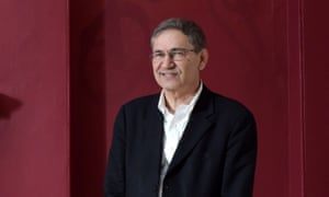 a portrait of orhan pamuk against a deep red background
