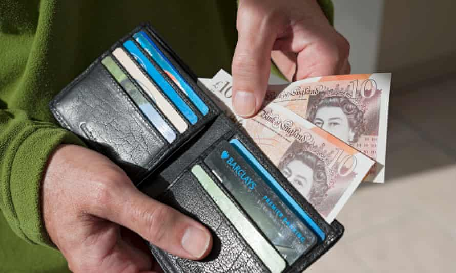 Cash being removed from a wallet
