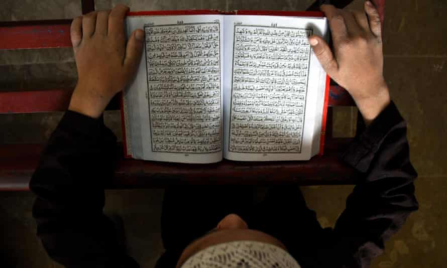 A boy reads the Qur'an at a mosque in Pakistan.