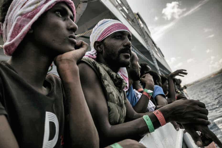 Yonas Menaki, 17, from Eritrea, watches from onboard as Aquarius approaches Malta after being refused entry to ports for several days