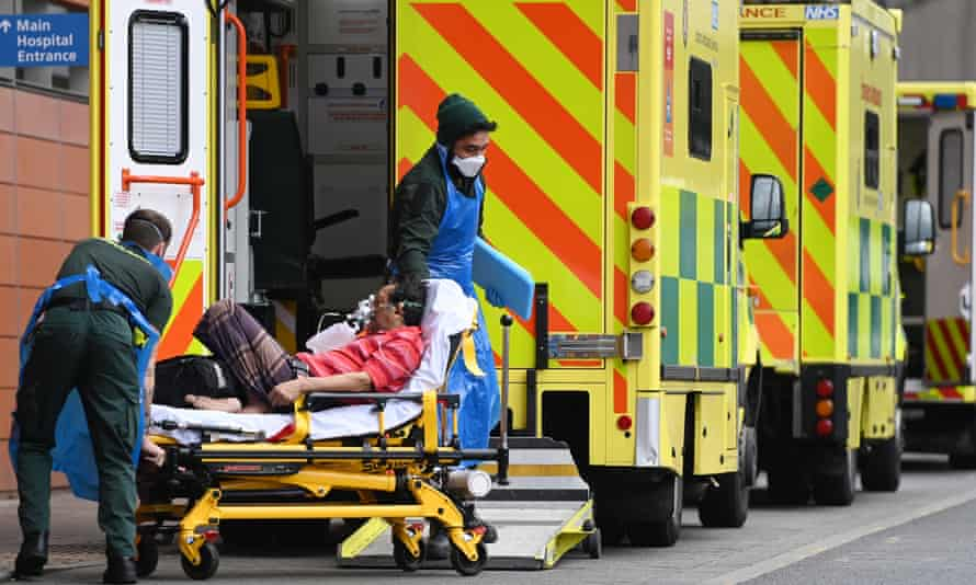 Ambulance staff bring a patient into the Royal London hospital in London.