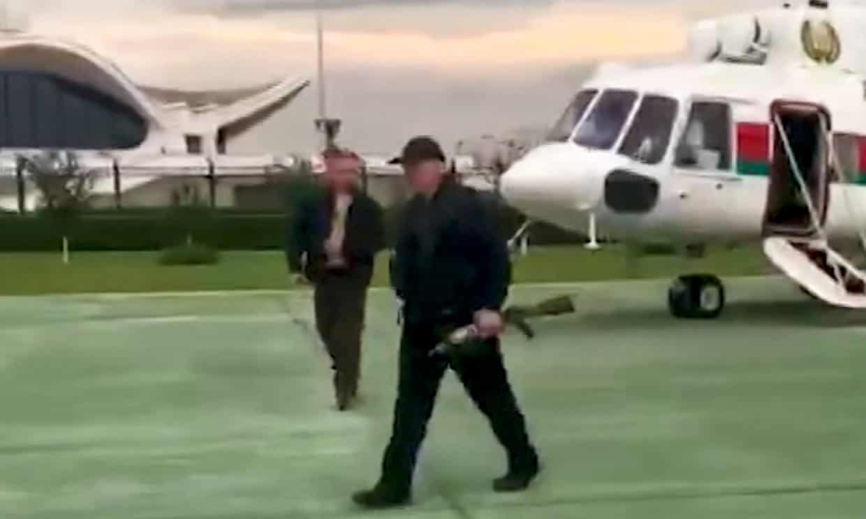 A video grab shows an armed Alexander Lukashenko walking from a helicopter last weekend. Photograph: AP