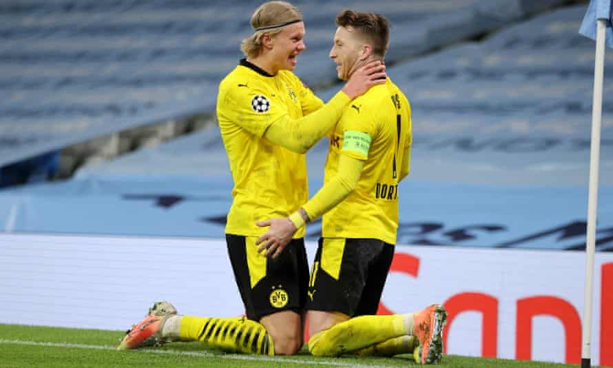 Marco Reus (right) and Erling Haaland celebrate an away goal against Manchester City.