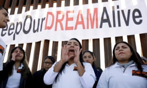 """""""Dreamers"""" react as they meet with relatives during a meeting on the US-Mexico border."""