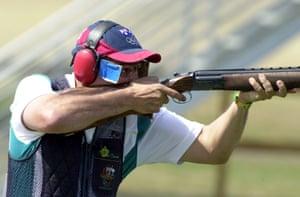 Australian marksman Michael Diamond pulls gold in the men's trap shooting.