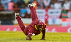Carlos Brathwaite of the West Indies attempts to catch Alex Hales of England.