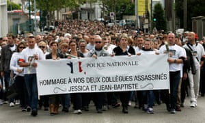 Around 2,500 French police officers walk in honour of the two victims of the stabbing attack.