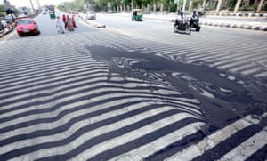 Road markings appear distorted during a heatwave in Delhi, India, in May 2015. More than 1,150 people died dead from a heatwave sweeping across south India and Andhra Pradesh state was the worst hit.