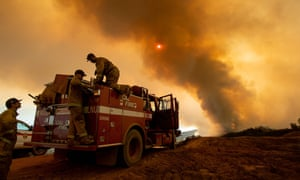 Firefighters battling the Ranch Fire, part of the Mendocino Complex fire, burning along High Valley Road near Clearlake Oaks, California.
