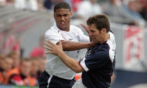 Greg Vanney tangles with England's Glen Johnson during his USA playing career