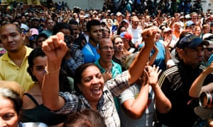 Supporters of Juan Guaido attend a rally in which he gave details of what he calls 'Operation Freedom', in Caracas on 27 March 2019.