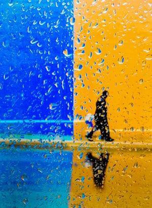 Wisconsin, US David Sullivan and his son, Donivin, walk home in the rain in Racine