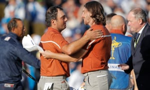 Francesco Molinari and Tommy Fleetwood of Europe celebrate victory on the 15th green in their afternoon foursomes match against Tiger Woods and Bryson DeChambeau.