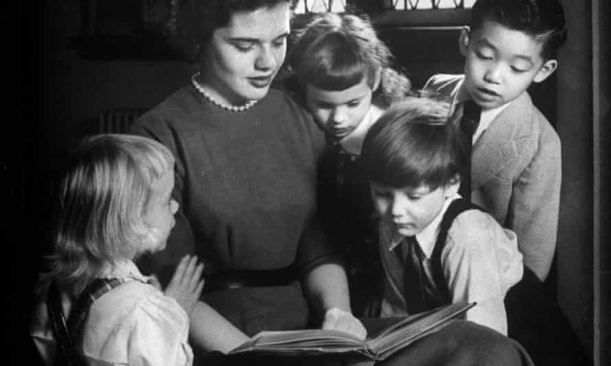 Undated picture of a Sunday school teacher reading a Christmas story to children at Trinity Episcopal Church.