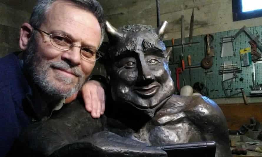 Sculptor José Antonio Abella with his statue of the devil.