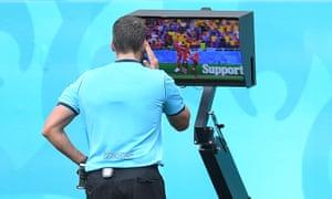 Referee Fernando Andres Rapallini checks the VAR screen before awarding Ukraine a penalty for handball.