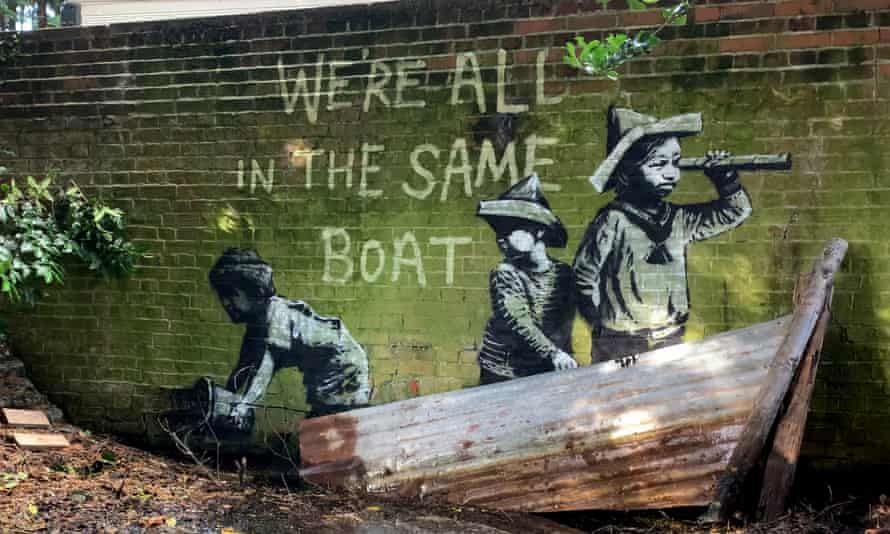 Street art that appeared on a wall in Nicholas Everitt Park, Lowestoft, Suffolk. The piece features one child looking ahead as though out to sea, another child behind looking over their shoulder, and a third child at the back of the boat appearing to be leaning over the side holding a bucket. It reads 'We're all in the same boat'