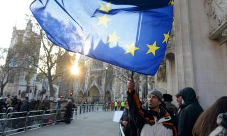 Man waves EU flag outside supreme court
