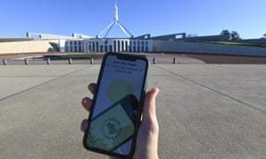 covidsafe app on phone in front of parliament house