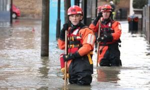 Firemen in floorwaters