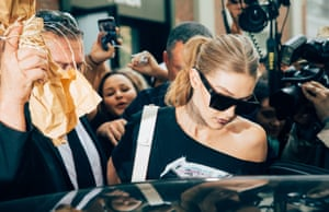 Hadid surrounded by photographers at Milan fashion week