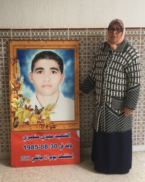 Om Saad with her son's Majdi's memorial.
