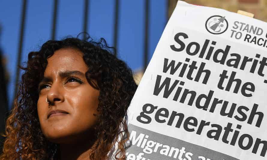 A protester at a London rally shows her support for the Windrush generation.