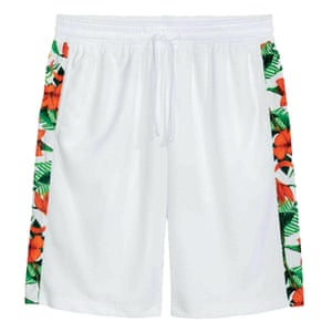 white shorts with patterned side panels red green black white