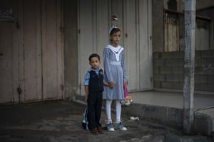 Gaza City Children wait outside a UN school before attending first day of class. Hundreds of thousands of Palestinian children are starting their school year amid a major budget crunch for the United Nations agency that funds many schools