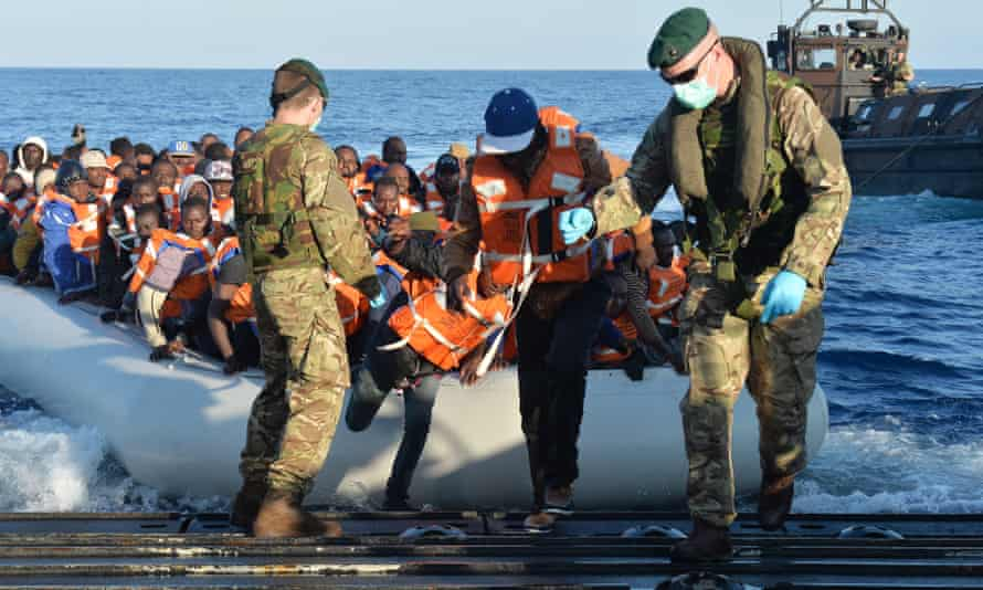 Royal Navy officers rescuing migrants in the Mediterranean