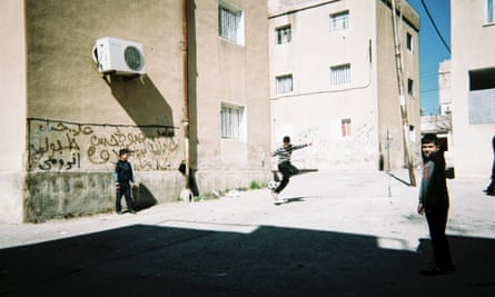 """Children playing street football in the neighbourhood of Hashem Shemali, in East Amman, Jordan. 'Even without proper football pitches and regardless of the environment we can adapt and our love of football prevails,"""" says photographer Abdelrahman Hasan al Attar."""