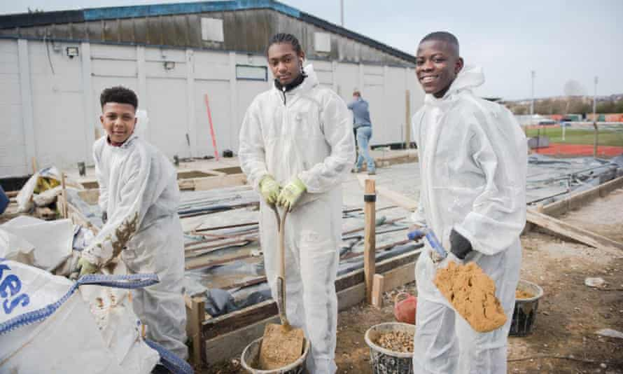 Kwadwo Baah (right) with Josh Brown and Azariah Howell during a volunteer scheme with Kinetic.