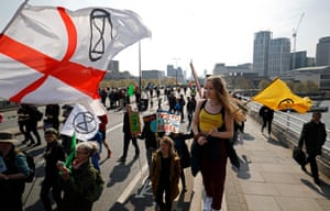Environmental demonstrators arrive on Waterloo Bridge during the Extinction Rebellion protest