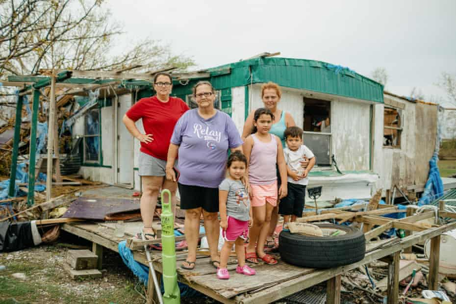 Earline Naquin, center, and her daughters Liza Naquin, left, and April Badillo, right, with April's three children at Earline's destroyed home in Pointe-aux-Chenes. Pieces of blue tarp hung over their roof after last year's Hurricane Zeta were cut to shreds by Ida.