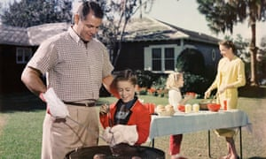 Father and Son Grilling Hamburgers, 1960s